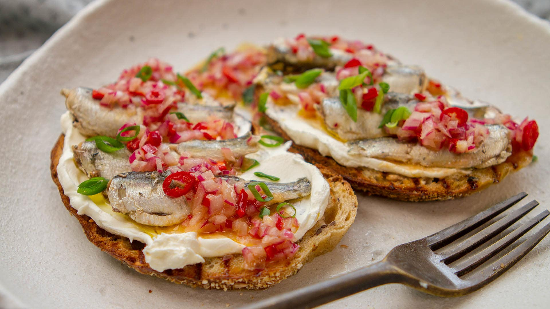 Sardine toast with red onion chilli vinaigrette