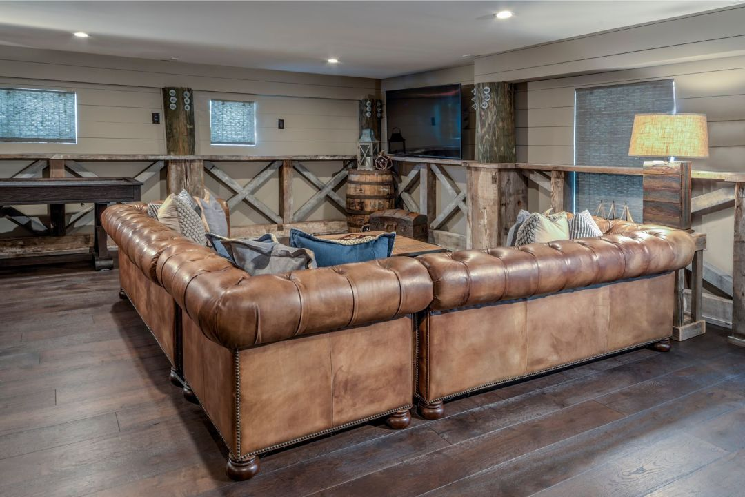Renovation in Bora-Bora, Fenwick Island DE with Large Leather Sofa and Dark Wood Flooring