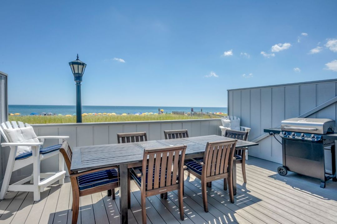 Deck Renovation in Campbell Place, Bethany Beach DE - Table with Six Wooden Chairs and Stainless Steel Grill