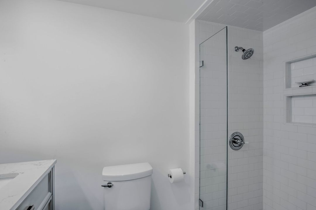 Renovation in Campbell Place, Bethany Beach DE - Bathroom with White Wall Paint and Glass Shower Screen