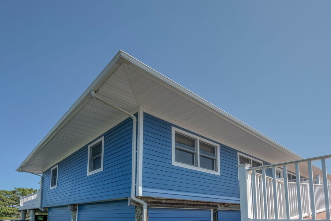 Exterior in Coastal Highway, Fenwick Island DE with Togo Loyal Blue Siding