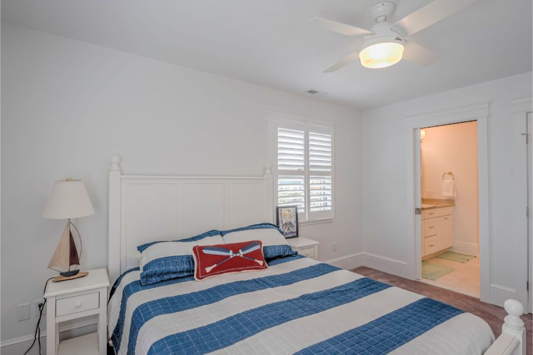 Renovation in Dune Road, Bethany Beach DE - Bedroom with White and Blue Striped Bed Cover and Night Lamp with Sailboat