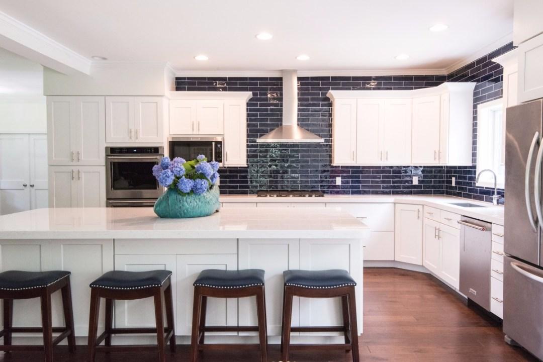Contemporary Kitchen Improvement in Jefferson Bridge, Bethany Beach DE with Center Island and White Cabinets