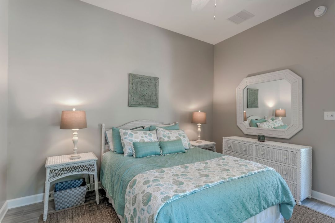 Addition in Juniper Court, Ocean Pines MD - Bedroom with Octagon Mirror and White Bedside Tables