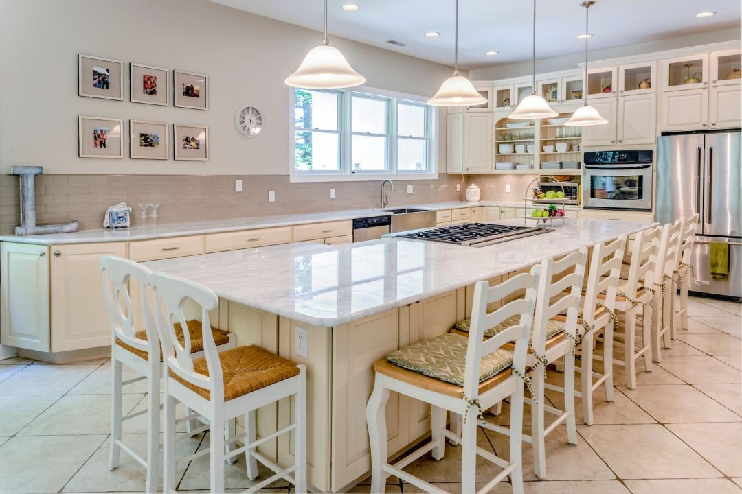 Addition in Juniper Court, Ocean Pines MD - Dining Area with Island, White Marble Countertop and White Tiles Flooring
