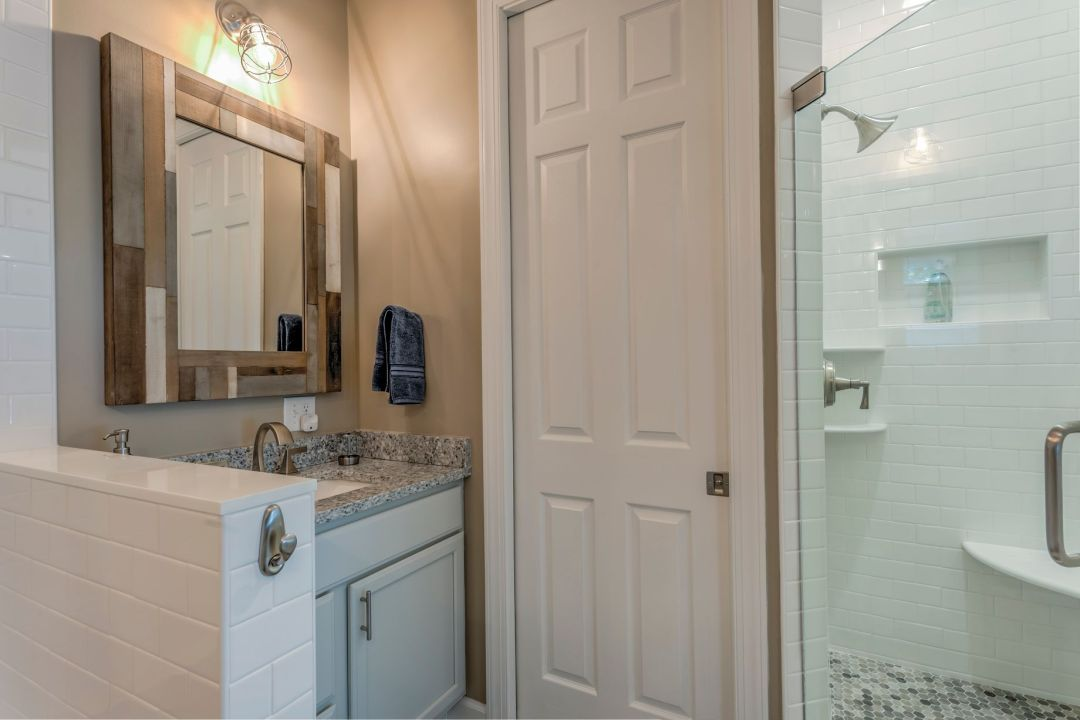 Bathroom in Juniper Court, Ocean Pines MD with Compact Sink and Large Square Mirror with Mosaic Frame