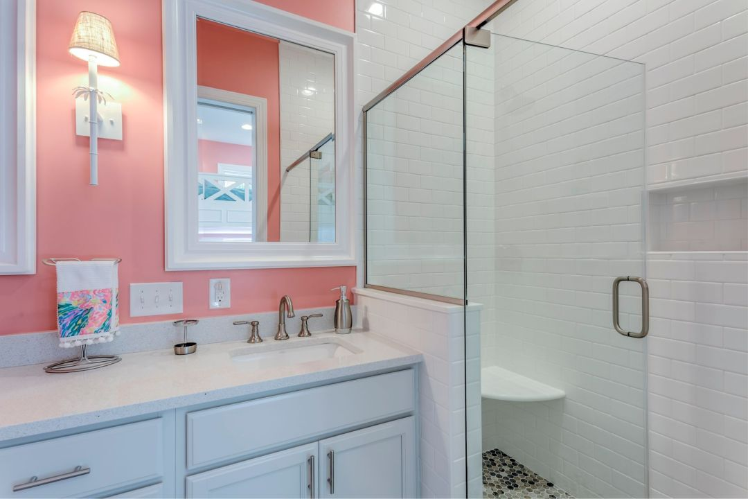 Bathroom in Juniper Court, Ocean Pines MD with Coral Wall Paint and Square Mirror with White Frame