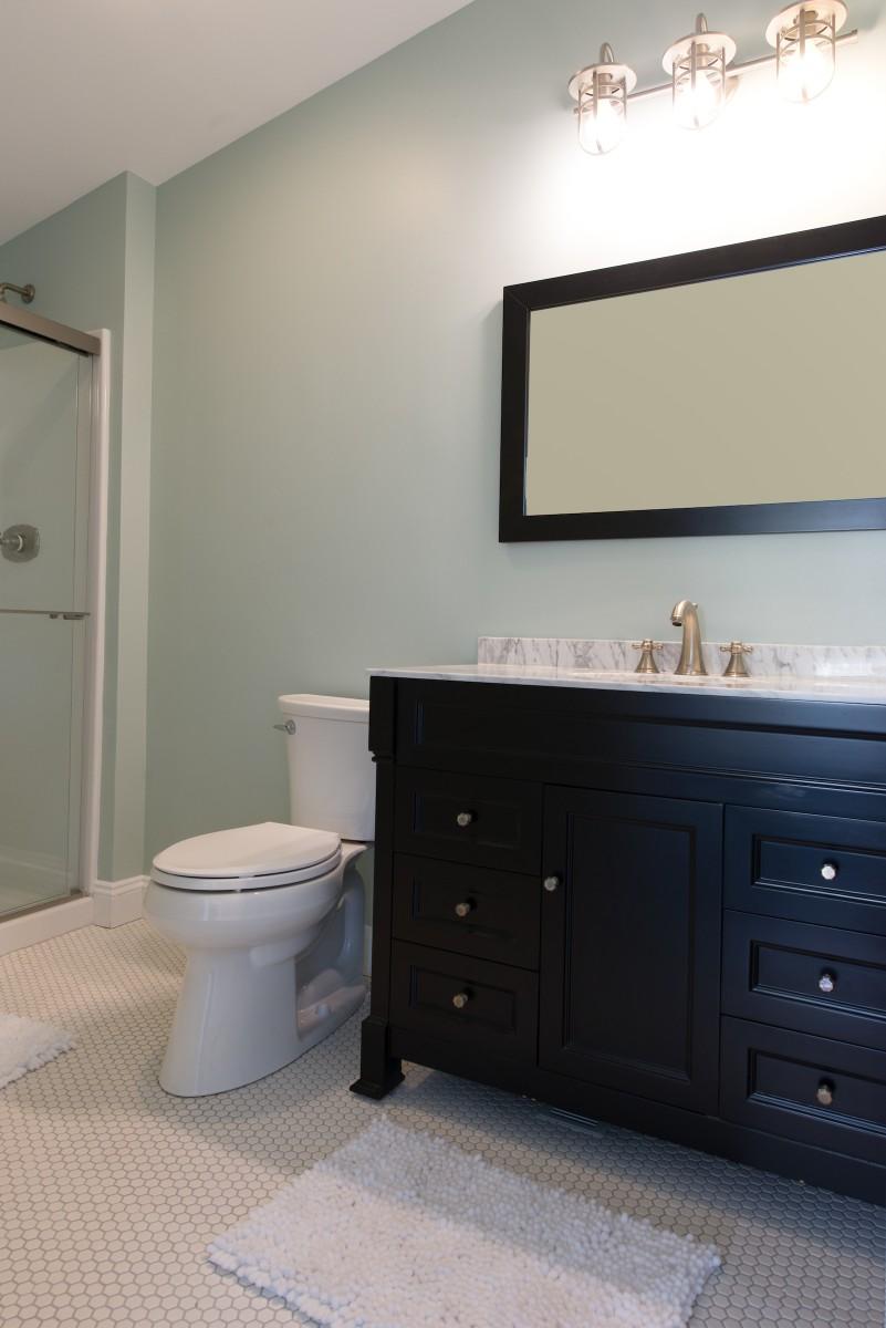 Kent Renovation Bethany Beach, DE Bathroom with Honeycomb White Floor Tiles, Dark Wood Vanity and Sea Foam Wall Paint