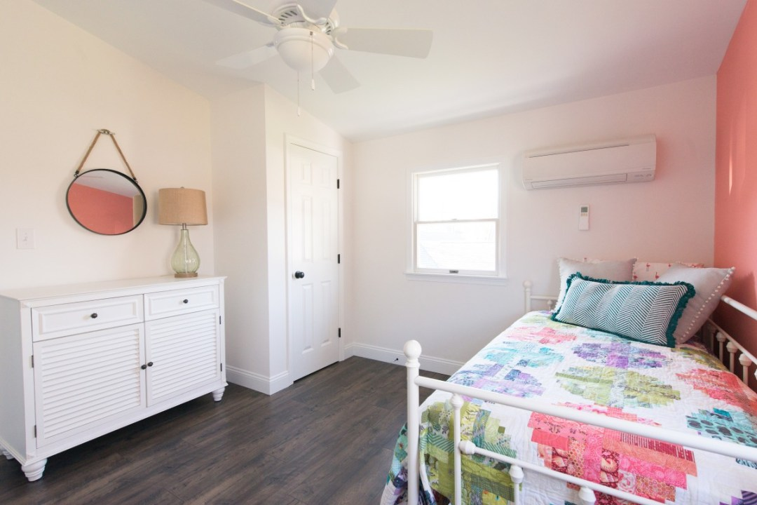 Kent Renovation Bethany Beach, DE Guest Bedroom with White Closet, Hanging Mirror and Dark Wood Flooring