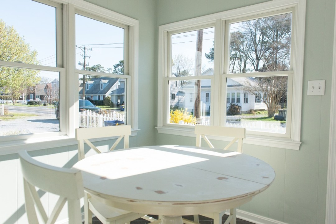 Kent Renovation Bethany Beach, DE Sunroom with Distressed Round White Table and White Windows Trim