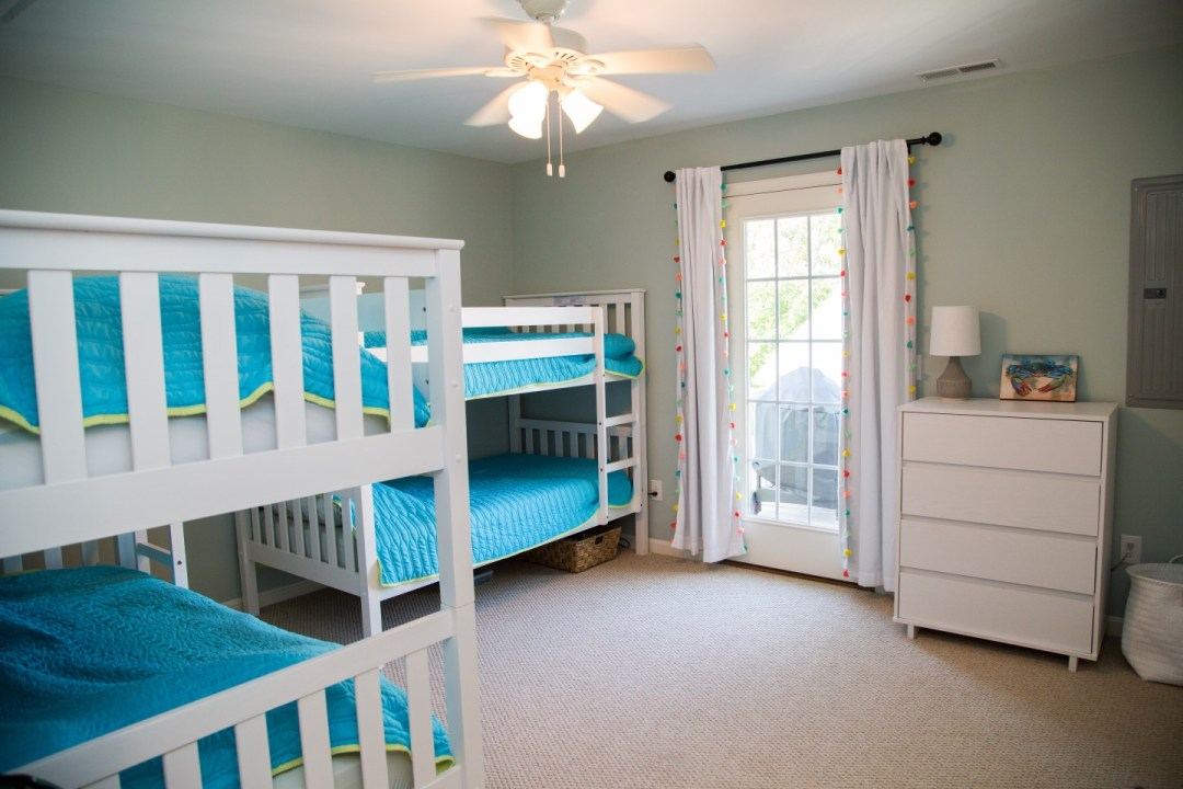 Kids Bedroom with Bunk Beds, Light Carpet and Large Window
