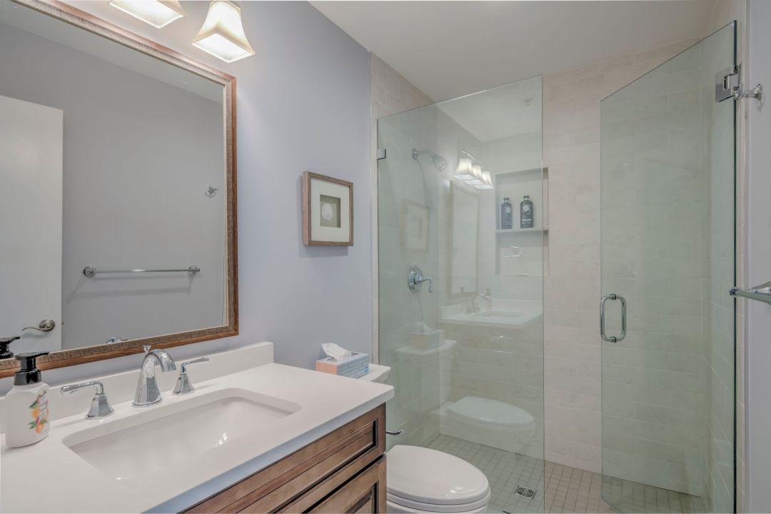 Bathroom Remodel in Kings Grant, Fenwick Island DE with Light Wood Vanity with White Top, and Large Square Mirror