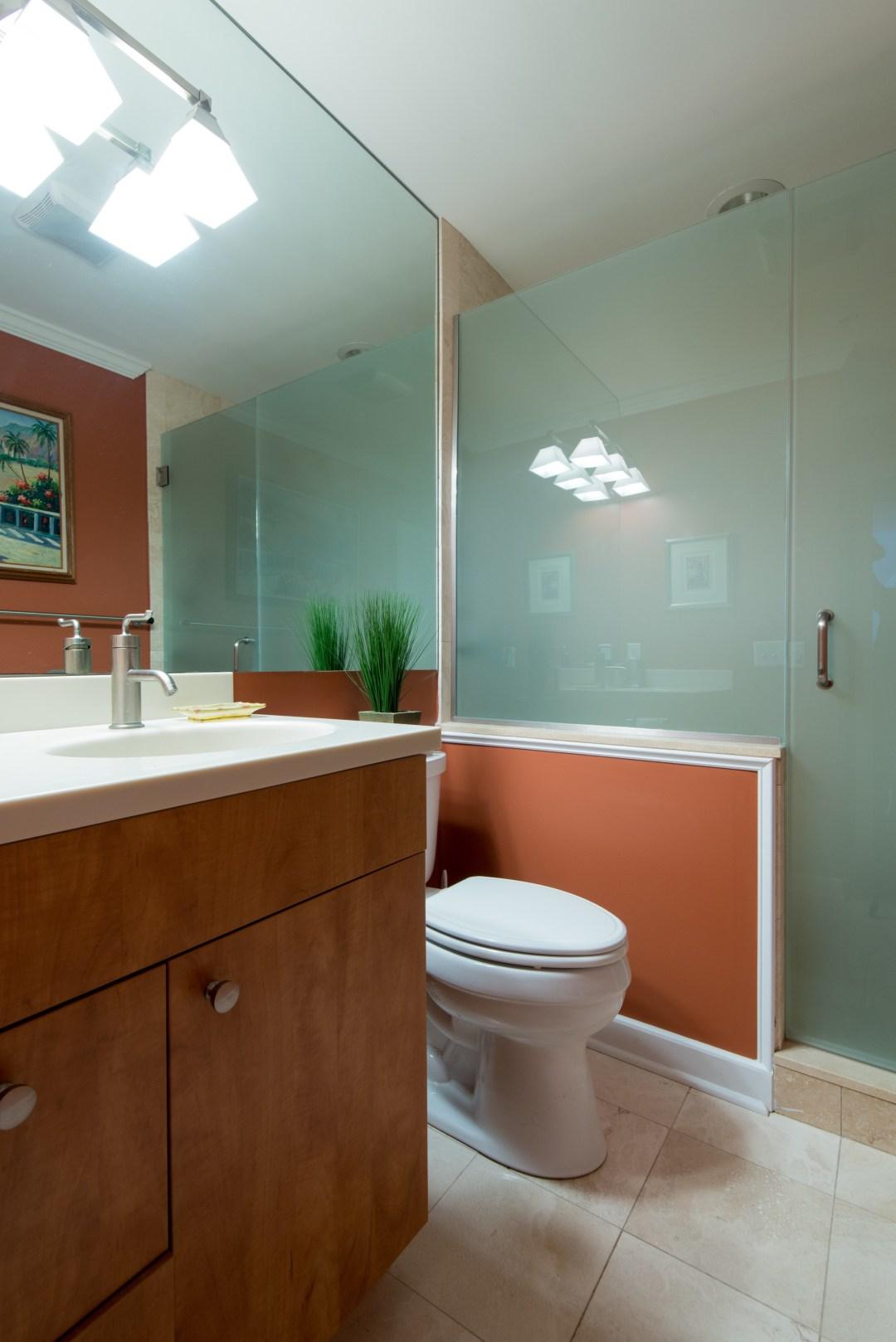 Bathroom Remodel in Kings Grant, Fenwick Island DE with Wood Vanity, White Top, Matte Glass Shower Door and Full Length Mirror