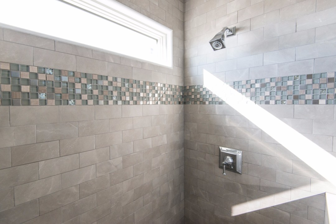 Bathroom Remodel in Kings Grant, Fenwick Island DE with Nordic Grey Wall Tiles, Decorative Glass Mosaic Tiles and Square Shower
