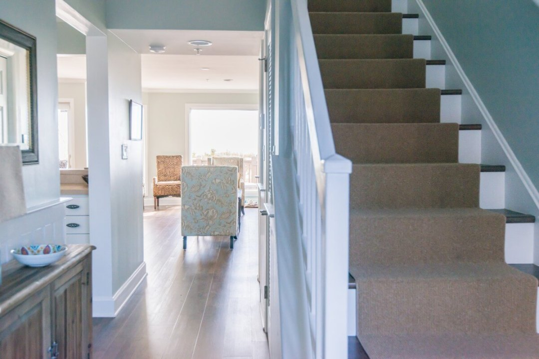 Kings Grant Renovation Vol.3 Fenwick Island, DE Hallway with White Railing and Dark Wood Stairs