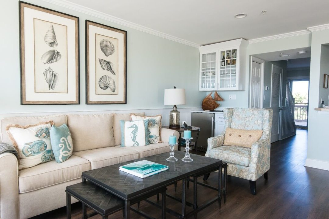 Kings Grant Renovation Vol.3 Fenwick Island, DE Living Room with Light Sea Foam Green Walls, Large Sofa and Dark Coffee Table