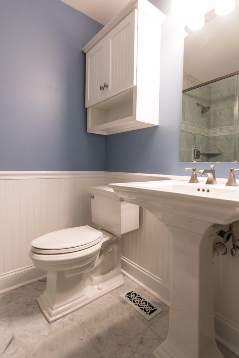 Bathroom Remodel in Ocean Ridge, Bethany Beach DE with Memoirs Pedestal Sink, Elongated Toilet, Mirror and White Cabinet