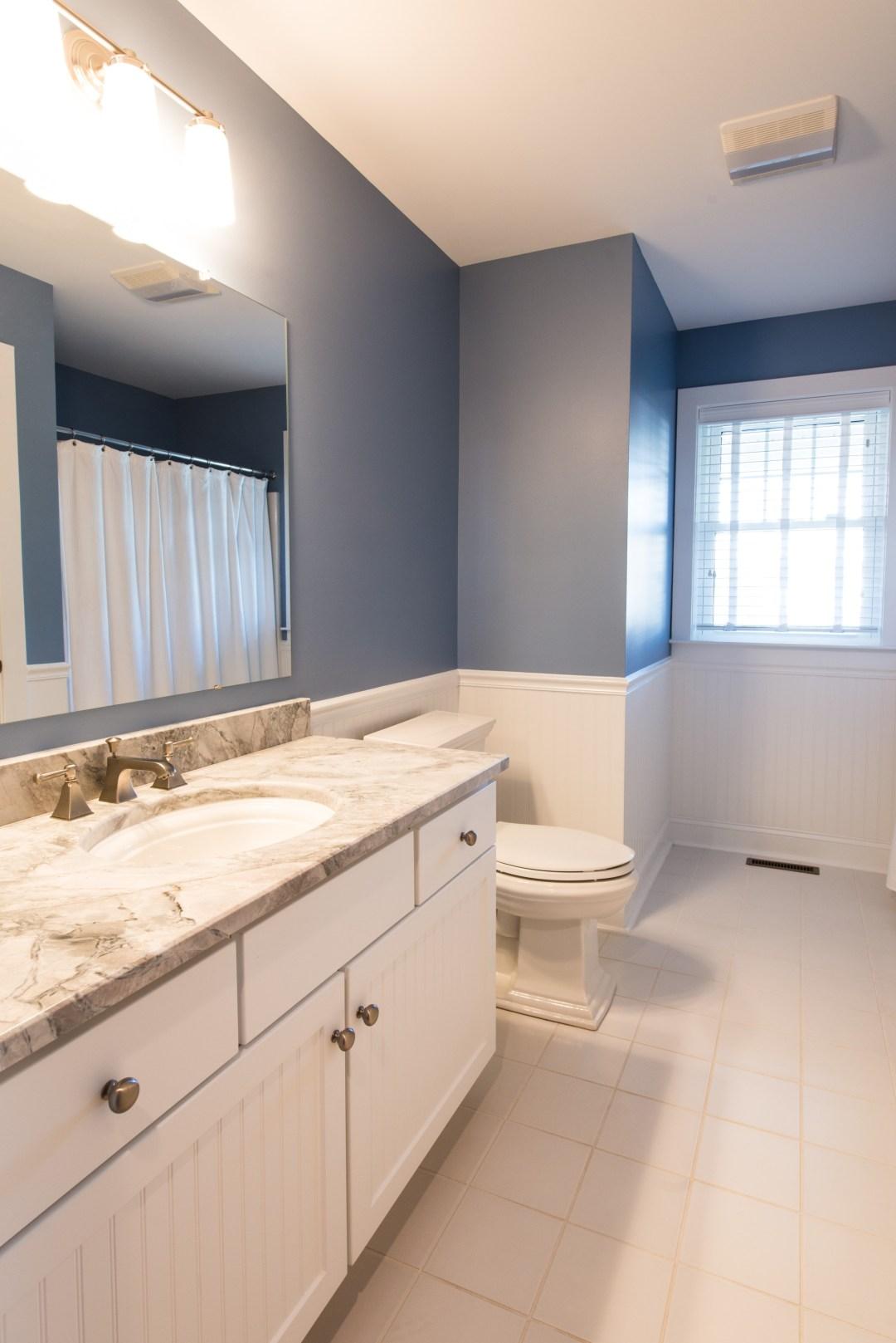 Bathroom Remodel in Ocean Ridge, Bethany Beach DE with White Floor Tiles, Memoirs Elongated Toilet and White Wood Vanity
