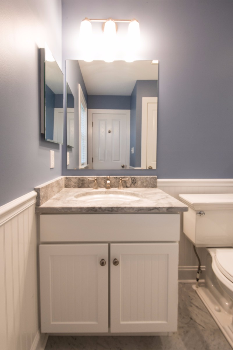 Bathroom Remodel in Ocean Ridge, Bethany Beach DE with White Wood Vanity, Light Grey Marble Top and Two Mirrors