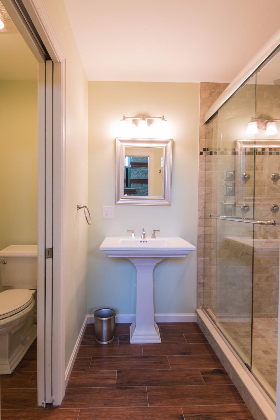 Bathroom Remodel in October Glory, Bear Trap Dunes, Ocean View DE with Dark Wood Floor Tiles and Memoirs Pedestal Sink