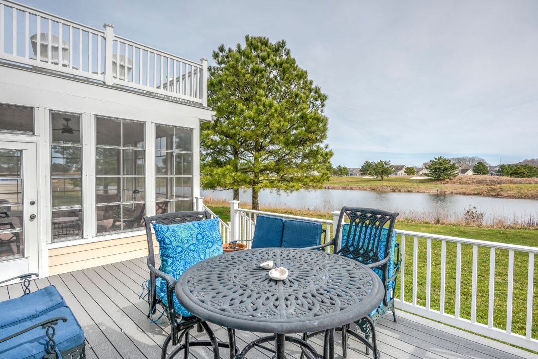 October Glory Exterior in Ocean View DE - Lower Deck with Vintage Metal Round Table