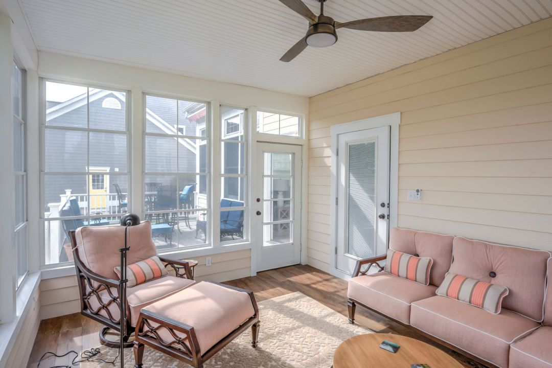 October Glory Exterior in Ocean View DE - Sunroom with Cozy Vintage Soft Furniture