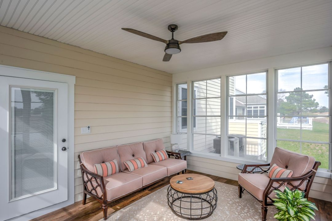 October Glory Exterior in Ocean View DE - Sunroom with Vintage Ceiling Fan and Round Coffee Table