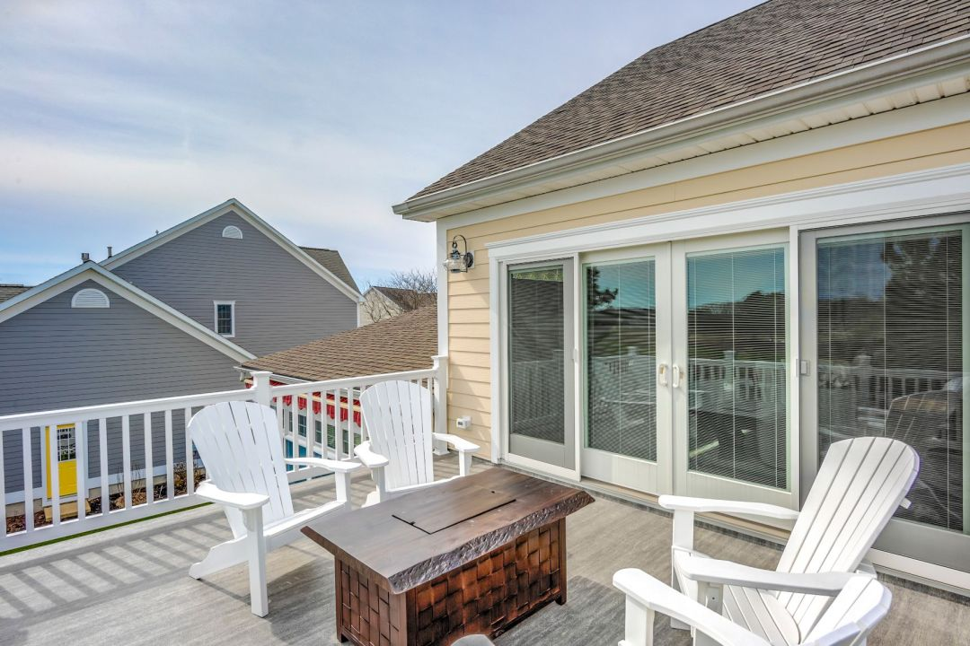October Glory Exterior in Ocean View DE - Upper Deck with White Chairs and Dark Wood Custom Table