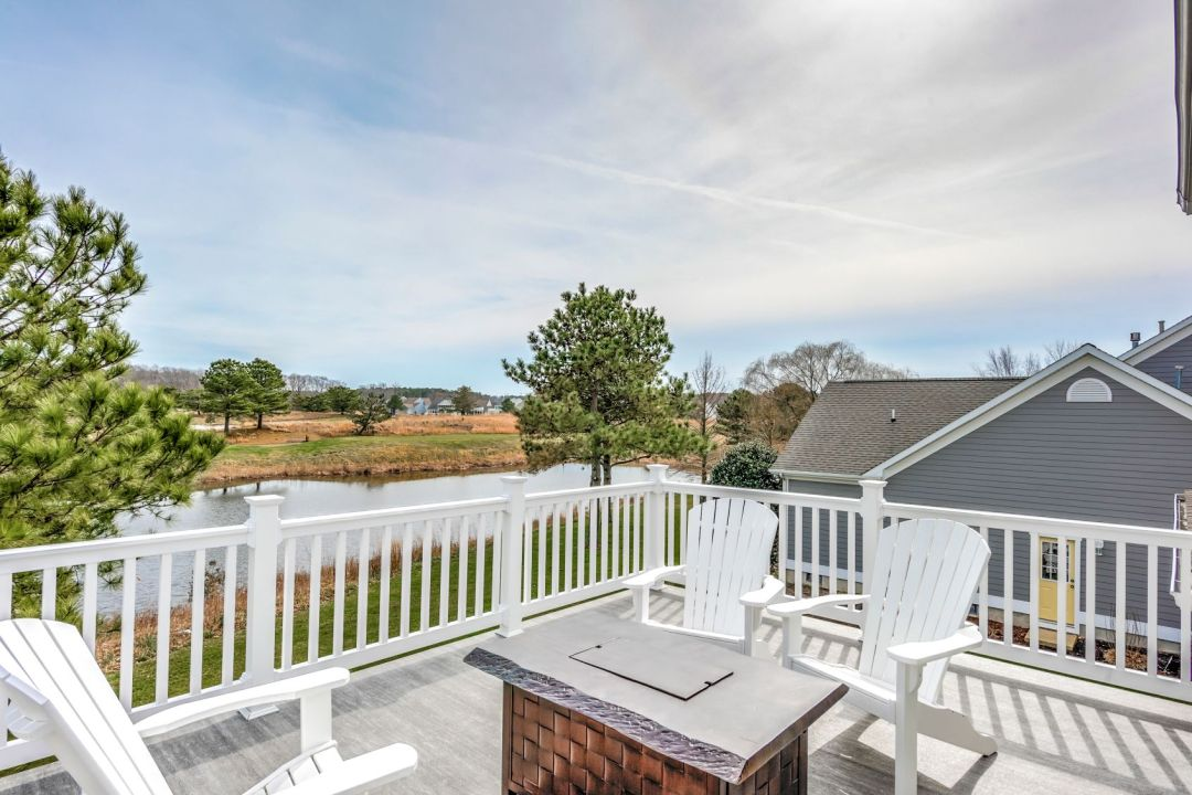 October Glory Exterior in Ocean View DE - Upper Deck with White Railing and Custom Wooden Table