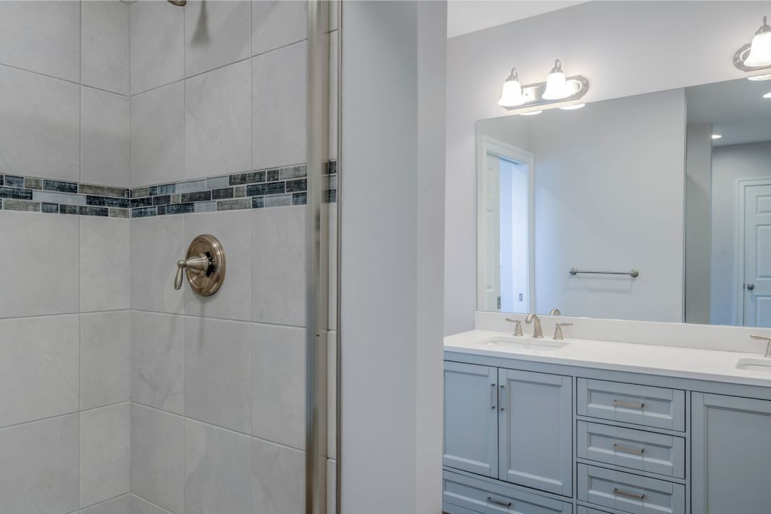 New Addition in October Glory, Ocean View DE - Bathroom with Bevalo 12x12 Dove Tiles and Blue Denim Mosaic Accent Tiles