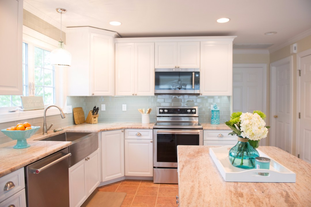 Traditional Kitchen Renovation in Pine Tree, Bethany Beach DE with White Maple Cabinets and Crackled Ceramic Backsplash