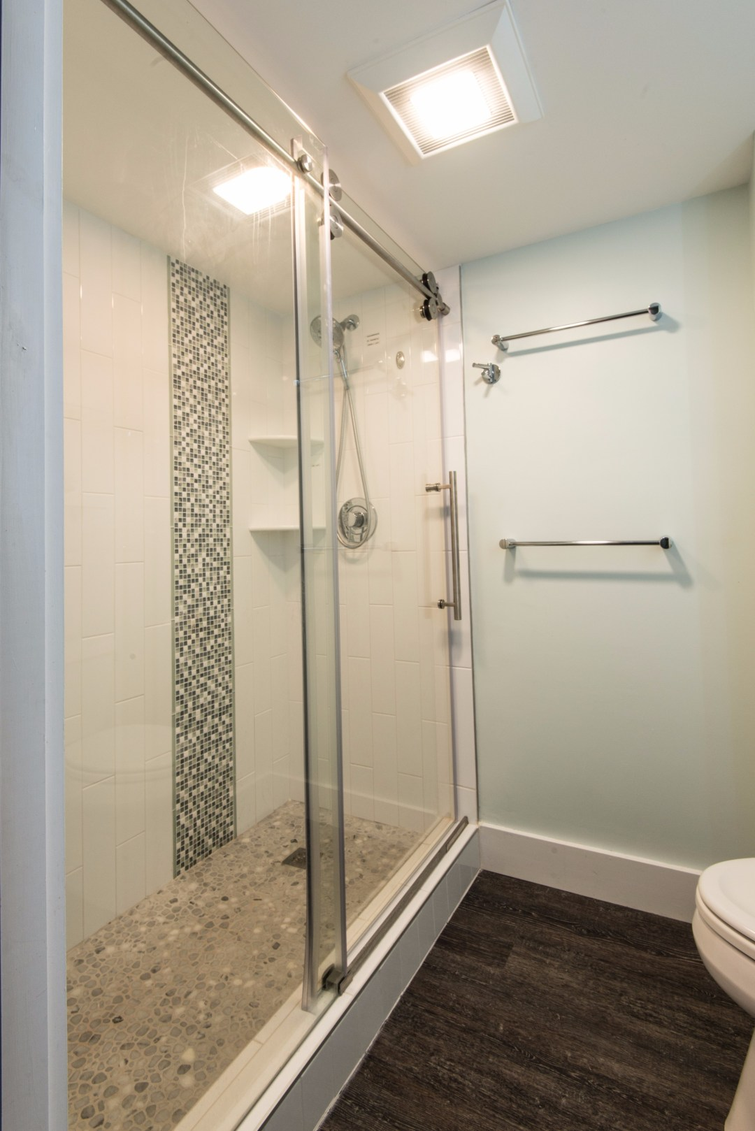 Bathroom Remodel in Sea Colony, Bethany Beach DE with Coretec Georgetown Oak Flooring and White Vertical Subway Wall Tiles