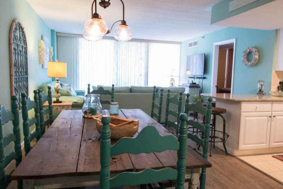 Sea Colony Condo Renovation Bethany Beach, DE with Turquoise Wall Paint, Vintage Wooden Dining Table and Vintage Chandelier