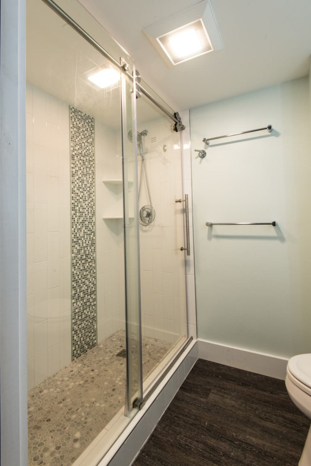 Sea Colony Condo Renovation Vol.2 Bethany Beach, DE Bathroom with Mosaic Shower Floor and Sliding Frameless Glass Shower Door