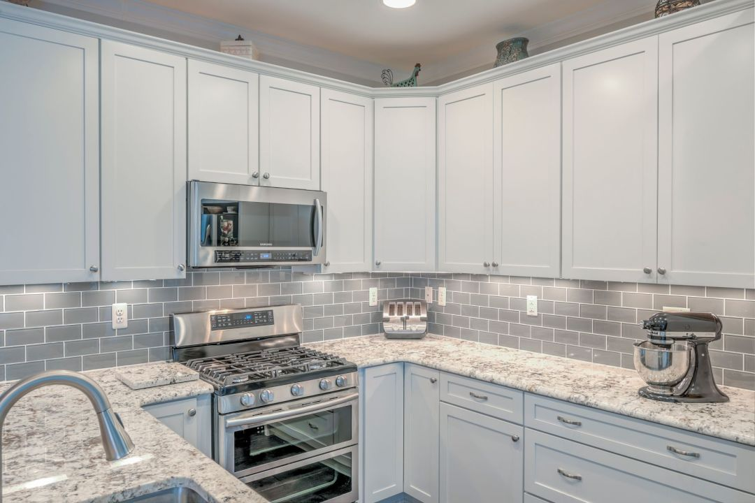 Kitchen Remodel in Shelter Drive, Selbyville DE with White Cabinets and Gray Subway Glass Backsplash Tiles