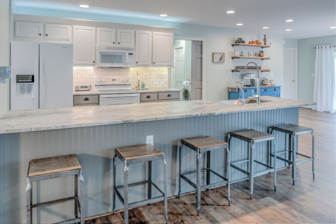Kitchen Remodel in Velta Drive, Ocean View DE with Center Island Granite Countertop and 5 Cast Iron Stools