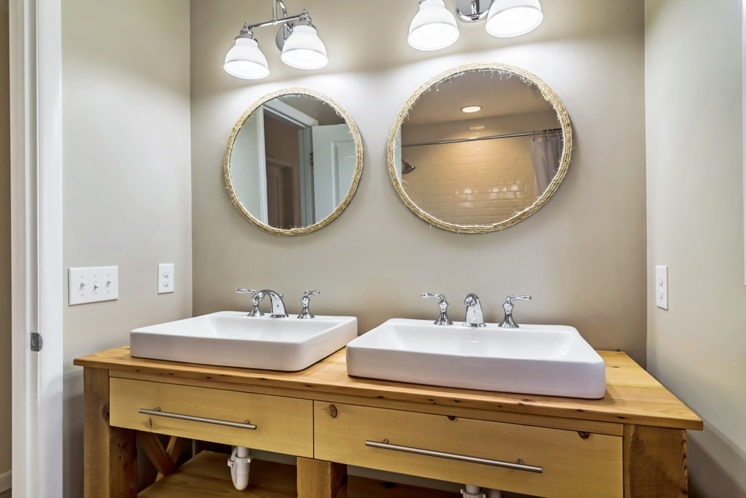 Bathroom Renovation in Wellington Parkway, Bethany Beach DE with Two Round Mirrors with Rope Outlining