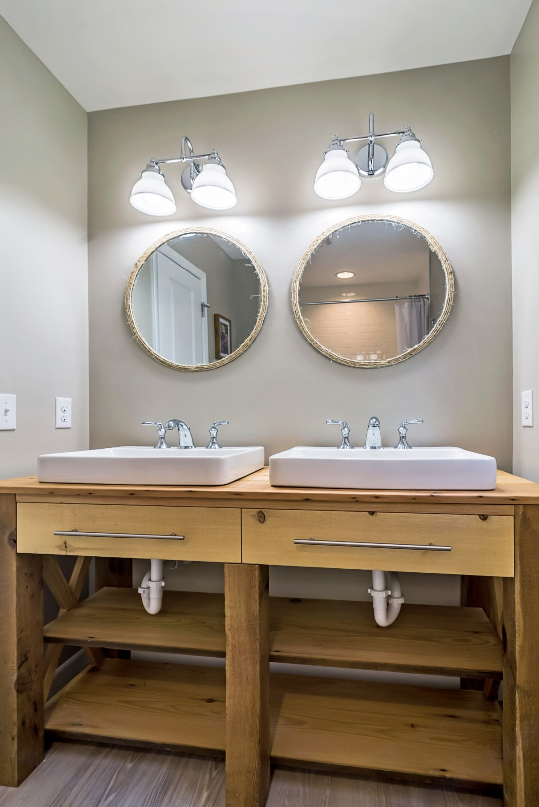 Bathroom Remodel in Wellington Parkway, Bethany Beach DE with Two Sinks, Chrome Faucets and Dual Double Lighting
