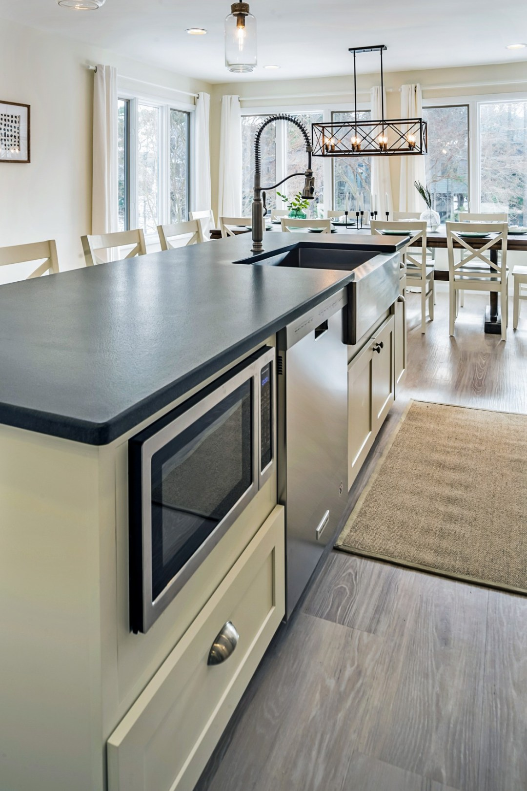 White Center Island with Black Countertop in Wellington Parkway, Bethany Beach DE Renovation