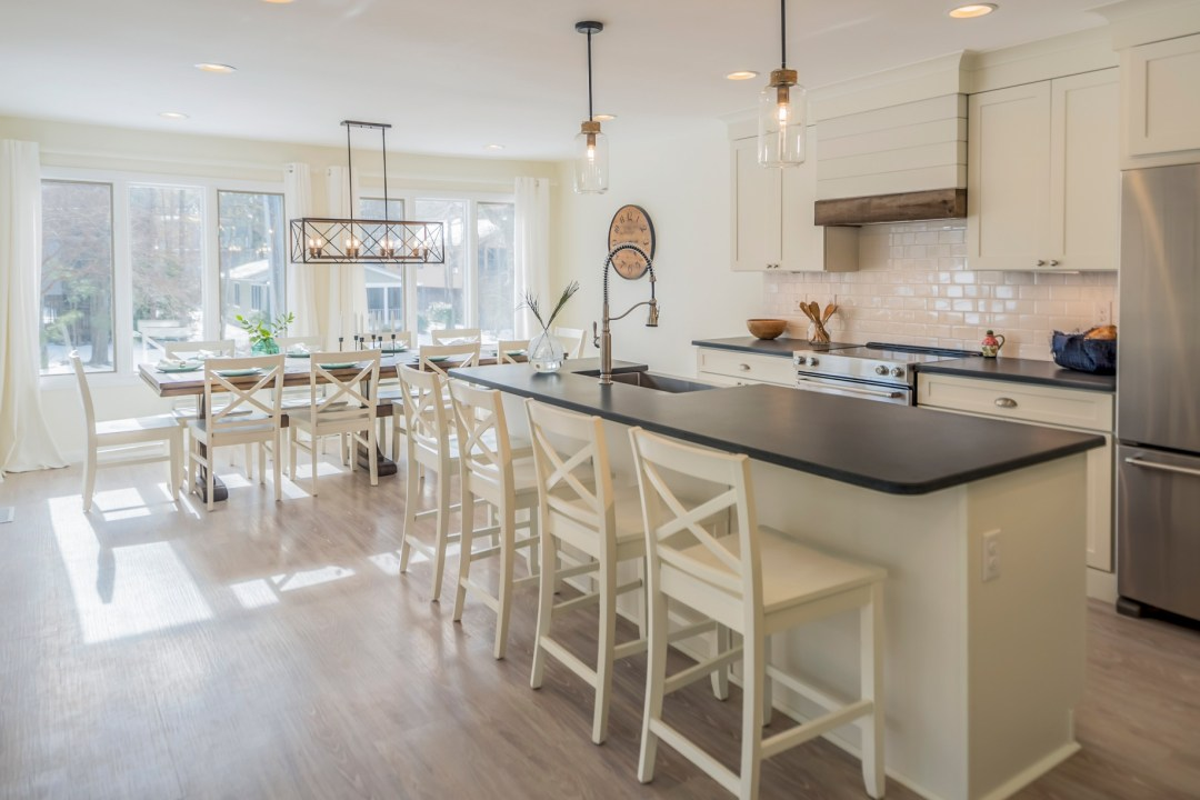 Modern Kitchen with Unique Center Island with Black Countertop in Wellington Parkway, Bethany Beach DE Renovation