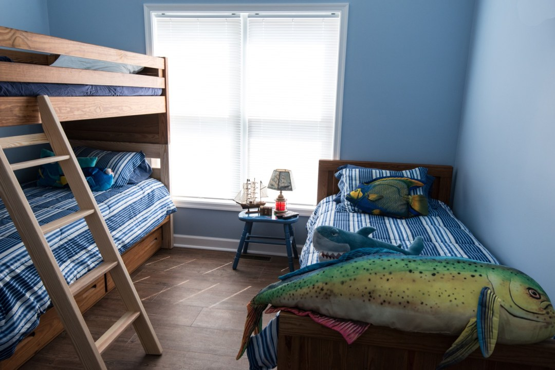 Whitesview Court House Lift New Addition in Ocean View DE Kids Bedroom with Twin Bunk Bed, Blue Walls and Wood Flooring