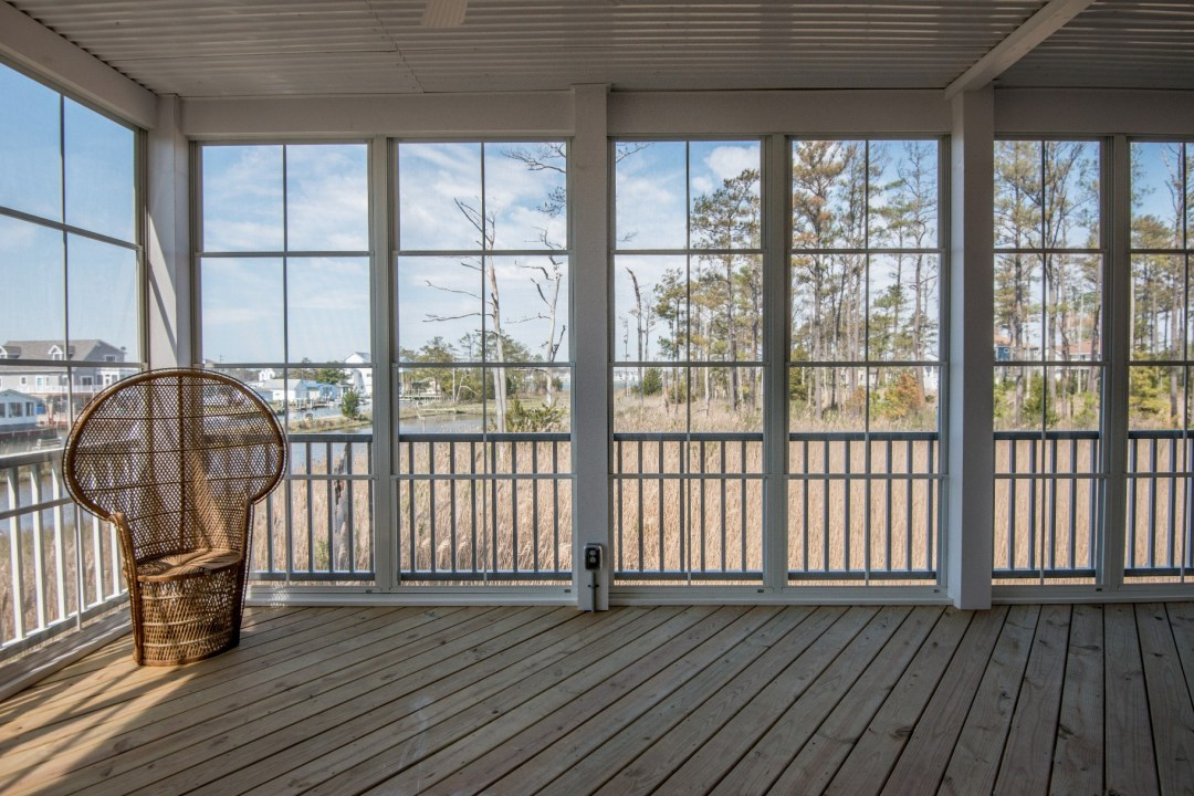 Whitesview Court Sunroom in Ocean View DE with White Front Railing, Wood Flooring and Electric System Power Outlets