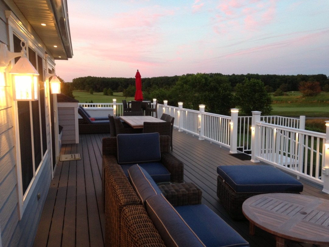 Willow Oak Deck Addition in Bear Trap Dunes, Ocean View DE with White Vinyl Railing with Lights and Round Table