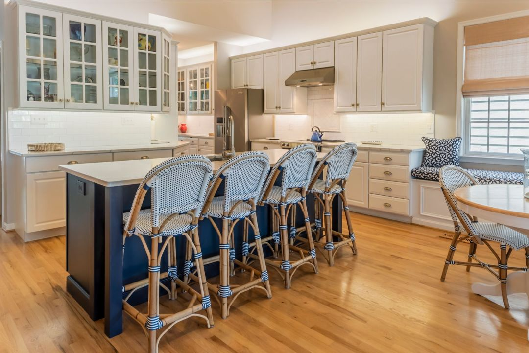 Kitchen Remodel in Willow Oak, Ocean View DE with Four Stools and Navy Blue Center Island Cabinets