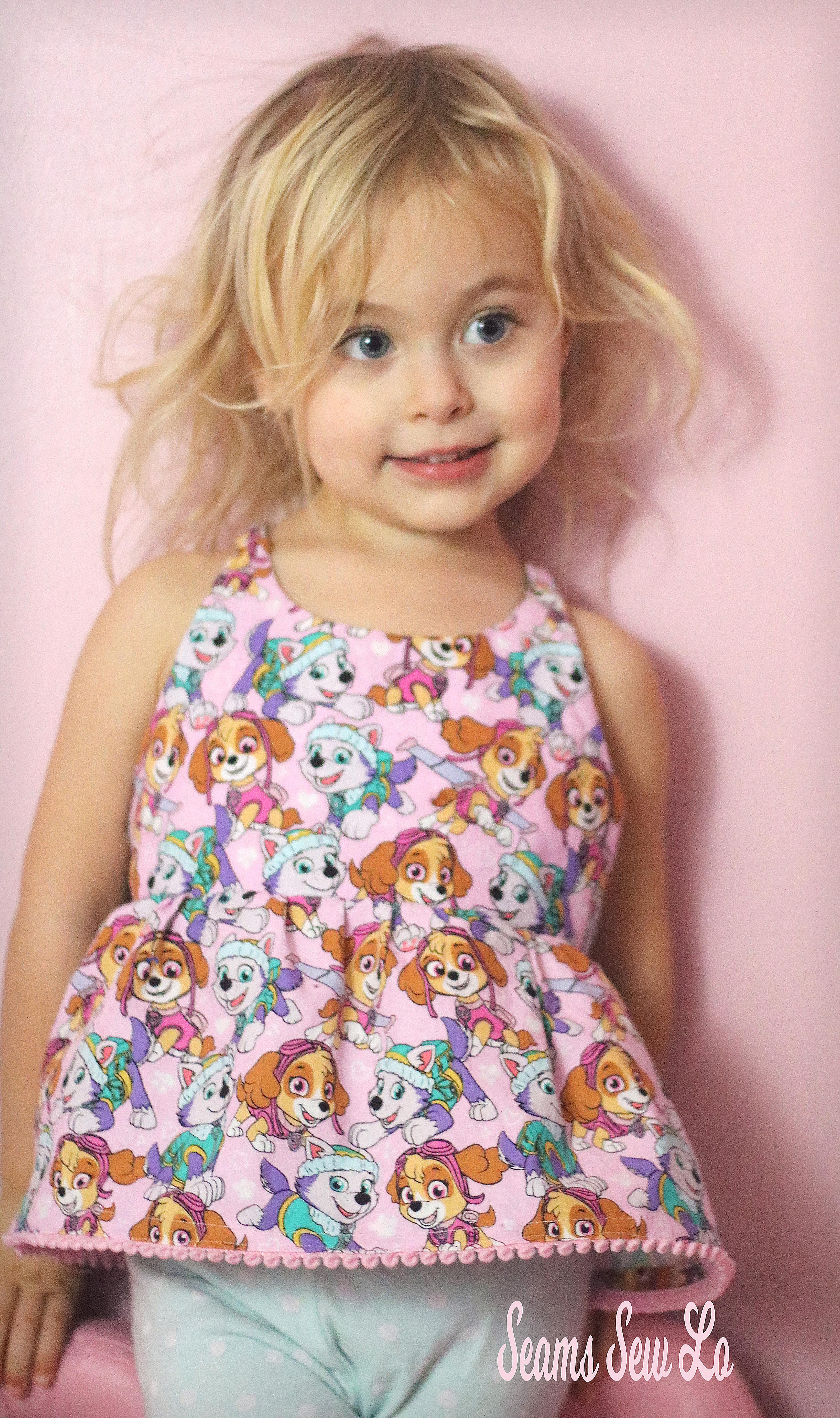 Petite Stitchery Periwinkle girls woven tunic in pink paw patrol Skye and Everest fabric pink pom pom trim