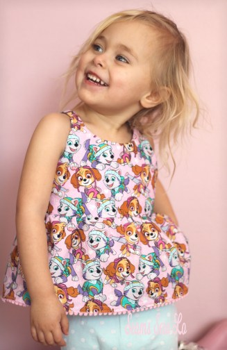 Petite Stitchery Periwinkle girls woven tunic in pink paw patrol skye and everest fabric