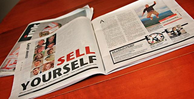 magazine open on a page with the title Sell Yourself