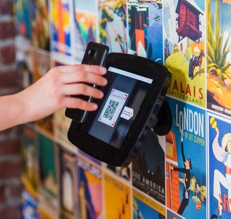 Person scanning a QR code with their mobile device