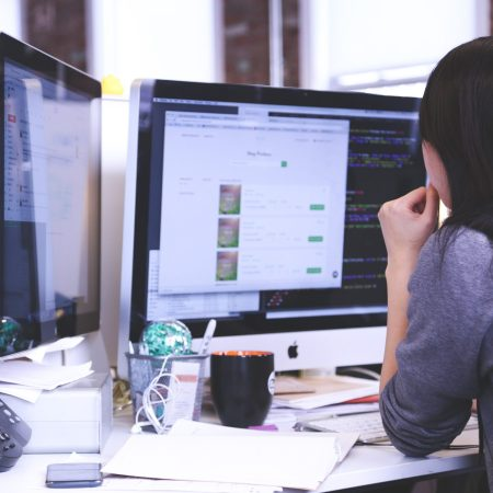 woman on desktop computer surfing the web