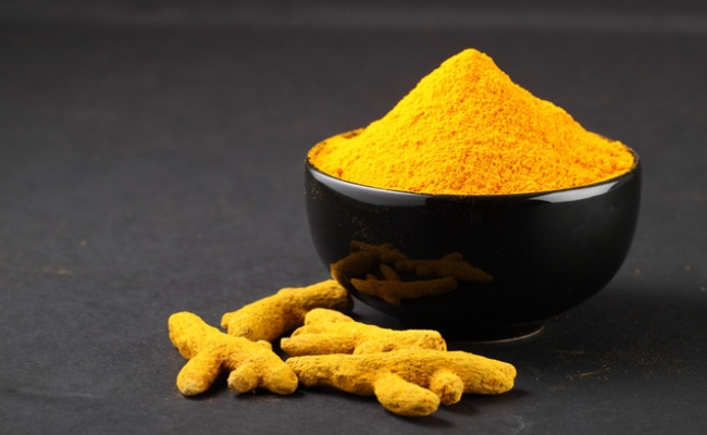 Mix Of Turmeric Powder And Cold Water